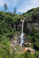 A tourist family visits Ramboda Falls in Sri Lanka, located in the Pussellawa area near the A5 highway at Ramboda Pass. (April 8, 2017)