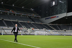 Burnley manager Sean Dyche walks the pitch at Newcastle United's St. James' park