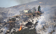May 15, 2014 - Escondido, California, U.S -<br /> <br /> California Wildfires 2014 - Cocos Fire<br /> <br />  Flames leap up the hills of San Marcos at the Cocos Fire. The  800-acre fire in San Marcos continued to burn out of control Thursday, threatening houses and forcing nearby residents from their homes. The fire burned at least three homes and one structure near Cal State San Marcos.<br /> ©Exclusivepix