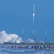 A general view from Playalinda Beach as an Atlas 5 rocket lifts off carrying a replacement satellite to strengthen the Global Positioning System for U.S. military forces and the worldwide economy. Liftoff from Cape Canaveral occurred on time at 5:38 p.m. from Cape Canaveral Launch Complex 41 in Titusville, Florida on Wednesday, May 15, 2013. (AP Photo/Alex Menendez)