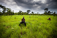 """Members of the vigilante """"arrow boys"""" militia stand guard during a meeting afte their town was attacked by the LRA. The militias have formed in villages in South Sudan to protect civilians from increasing LRA attacks."""