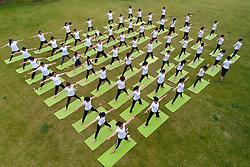 June 21, 2017 - Huai'an, China - Hundreds of people practice yoga at a park in Huai'an, east China's Jiangsu, June 21st, marking International Yoga Day 2017. (Credit Image: © SIPA Asia via ZUMA Wire)