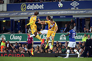 Phil Jagielka of Everton jumps for the ball between Christian Benteke and James McArthur of Crystal Palace. Premier league match, Everton v Crystal Palace at Goodison Park in Liverpool, Merseyside on Friday 30th September 2016.<br /> pic by Chris Stading, Andrew Orchard sports photography.