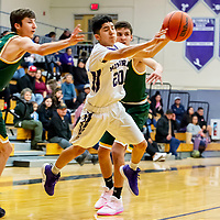Photo - Jefffery Jones<br /> <br /> Miyamura Patriot Mathias Rodriguez jumps and passes the ball during Saturday afternoon's 58-52 loss to the Los Alamos Hilltoppers.