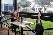 Sydney, Australia. Friday 15th May 2020. A restaurant in Sydney's inner west called Five Dock Dining has added cardboard cutouts of people to dining tables in order to create a better atmosphere for diners. Cafes, restaurants, and hotel dining areas are able to reopen  today but can only serve 10 guests at a time as the coronavirus pandemic restrictions ease.