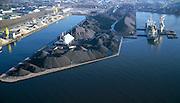 Nederland, Zeeuwsch-Vlaanderen, Terneuzen, 15/11/2001; opslag en overslag van kolen en ander bulkgoed in de haven van Terneuzen, gelegen aan Kanaal Terneuzen-Gent;.kustvaart scheepvaart havenkraan lichters steenkool erts insteekhaven, zie ook detailfoto's.luchtfoto (toeslag), aerial photo (additional fee)<br /> photo/foto Siebe Swart