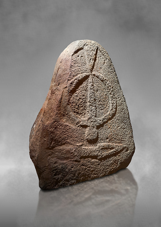 Late European Neolithic prehistoric Menhir standing stone with carvings on its face side. The representation of a stylalised male figure starts at the top with a long nose from which 2 eyebrows arch around the top of the stone. below this is a carving of a falling figure with head at the bottom and 2 curved arms encircling a body above. at the bottom is a carving of a dagger running horizontally across the menhir. Excavated from Piscina 'E Sali II site,  Laconi. Menhir Museum, Museo della Statuaria Prehistorica in Sardegna, Museum of Prehoistoric Sardinian Statues, Palazzo Aymerich, Laconi, Sardinia, Italy .<br /> <br /> Visit our PREHISTORIC PLACES PHOTO COLLECTIONS for more photos to download or buy as prints https://funkystock.photoshelter.com/gallery-collection/Prehistoric-Neolithic-Sites-Art-Artefacts-Pictures-Photos/C0000tfxw63zrUT4