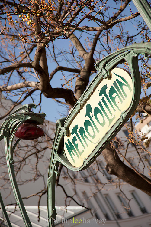 The iconic Metro sign for the subway system in Paris, France
