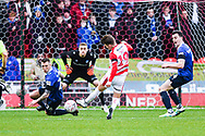 Alfie May of Doncaster Rovers (19) shoots with Peter Clarke of Oldham Athletic (26) and George Edmundson of Oldham Athletic (4) blocking during the The FA Cup fourth round match between Doncaster Rovers and Oldham Athletic at the Keepmoat Stadium, Doncaster, England on 26 January 2019.