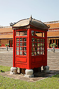 Bronze dragons encased in a structure resembling a red phone box, Hien Lam Courtyard, Hue Citadel / Imperial City, Hue, Vietnam