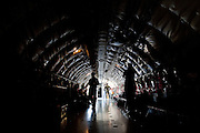 Flight crew and members of the media prepare for the refueling run aboard the KC-135R Stratotanker taking off from Fairchild Air Force Base in Spokane Washington on Thursday. The mission, open to members of the press, met the U.S. Air Force Thunderbirds in flight over southeast Washington and proceeded to fill up the tanks of each of the six F-16's en route to Spokane.