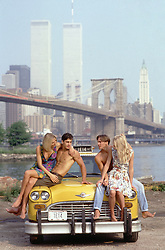 Two couples on a taxi in front of the World Trade Center in New York City