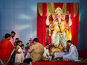 "23 SEPTEMBER 2018 - BANGKOK, THAILAND:  A family gets blessings at the Ganesha Festival at Wat Dan in Bangkok. Ganesha Chaturthi also known as Vinayaka Chaturthi, is the Hindu festival celebrated on the day of the re-birth of Lord Ganesha, the son of Shiva and Parvati. The festival, also known as Ganeshotsav (""festival of Ganesha"") is observed in the Hindu calendar month of Bhaadrapada, starting on the the fourth day of the waxing moon. The festival lasts for 10 days, ending on the fourteenth day of the waxing moon. Outside India, it is celebrated widely in Nepal and by Hindus in the United States, Canada, Mauritius, Singapore, Thailand, Cambodia, and Burma.  PHOTO BY JACK KURTZ"