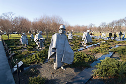 Washington DC; USA: The Korean War Veterans Memorial.  The statues of soldiers in a platoon march warily across a field..Photo copyright Lee Foster Photo # 9-washdc76258