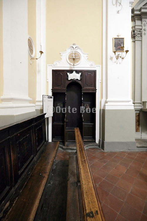 confessional with church bench Italy