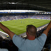 Leicester City' fans welcome the teams out at the new walkers Stadium