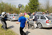France, April 13th 2014: Saxo Tinkoff's Jesper Hansen is attended by the race doctor at Pont Gibus, Wallers, during the Paris Roubaix 2014 cycle race.