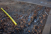 A yellow foam tube lying on a muddy patch of ground on Thurlow Street, on 28th November 2016, in the south London borough of Southwark, England.