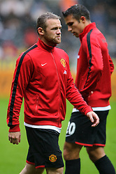 Man Utd Forward Wayne Rooney (ENG) walks past Man Utd Forward Robin van Persie (NED) during th warm up before the match - Photo mandatory by-line: Rogan Thomson/JMP - Tel: Mobile: 07966 386802 17/08/2013 - SPORT - FOOTBALL - Liberty Stadium, Swansea -  Swansea City V Manchester United - Barclays Premier League - First round of the 2013/14 season and the first league match for new Man Utd manager David Moyes.