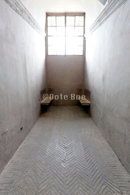 end of narrow hall with two benches