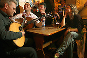 """Jose Manuel Castro, Andre Gomes e Artur Batalha having fun at """"Tasca do Chico"""". This one of the typical spots were to see live perfomances of Fado music and were the audience can spontaneously participate and also ask to sing. It is located in  Bairro Alto neighborhood"""