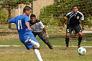 Deportivo Colomex Goalkeeper Jose Cormona (L) and defenseman Ivan Rodriguez (R) prepare to defend against a Team Shlama F.C. goal during National Soccer League play in Skokie, Il.