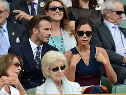 © Licensed to London News Pictures. 6th July 2014. London. UK. David & Victoria Beckham watch from the Royal Box. Crowds and celebrities watch the The Men's Final between Roger Federer, SUI v Novak Djokovic, SER at the Wimbledon Tennis Championships 2014. Photo credit :  Mike King/LNP