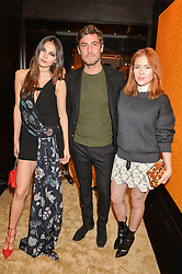 Left to right, DOINA CIOBANU, ROBERT KONJIC and ANGELA SCANLON at the Louis Vuitton for Unicef Event #MAKEAPROMISE held at The Apartment, 17-20 New Bond Street, London on 14th January 2016.