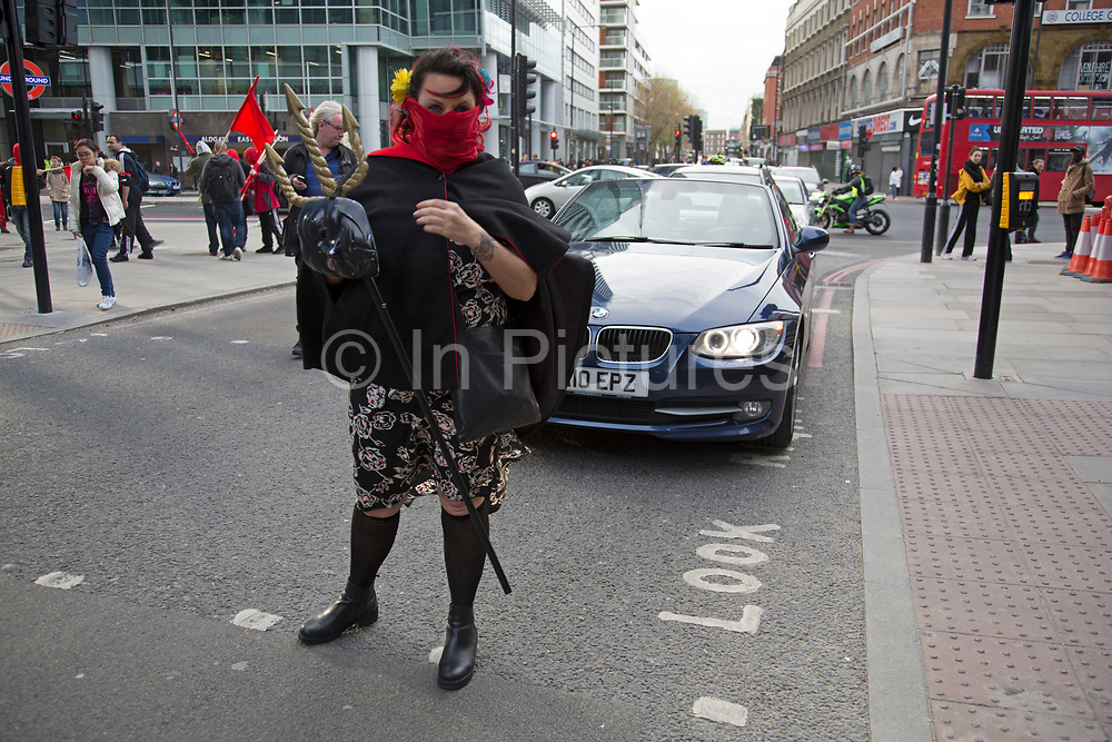 Anarchists gather as a black bloc for the Fuck Parade to party and protest at the class and wealth divide between rich and poor and the gentrification of London, the demonstration was organised by anarchist group Class War on May 1st 2016 in London, United Kingdom. The parade is now part of the May Day activism calendar as dissatisfaction about the establishment, the police and the inadequacy of the press is highlighted.