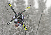 SHOT 12/18/10 10:39:02 AM - Simon Dumont of Bethel, Maine twists and spins while airborne high above the superpipe during the Supeprpipe Finals at the Nike 6.0 Open stop of the Winter Dew Tour at Breckenridge Ski Resort in Breckenridge, Co. Dumont would go on to win the event with a score of 94.50 on a stellar second run. The event features ski and snowboard slopestyle and superpipe. (Photo by Marc Piscotty / © 2010)