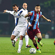 Trabzonspor's Burak YILMAZ (R) and Inter's Dejan STANKOVIC (L) during their UEFA Champions League group stage matchday 5 soccer match Trabzonspor between Inter at the Avni Aker Stadium at Trabzon Turkey on Tuesday, 22 November 2011. Photo by TURKPIX