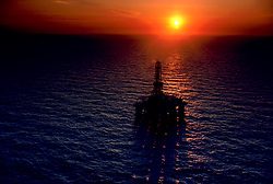 Stock photo of a semi submersible offshore drilling rig at sunset in the Gulf of Mexico