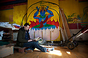 WATERLOO, LONDON, UK - APRIL 1, 2013. Jonathan James Harrison. Interior of squat, based in a disused buddhist temple where subjects working with Bitcoin operate. This squat is also where Occupy London activists are based. (Photo by Mike Kemp / For The Washington Post.)