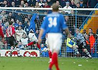Photo: Scott Heavey.<br /> Portsmouth v Southampton. FA Barclaycard Premeirship. 21/03/2004.<br /> Yakubu fires in the winner for Portsmouth