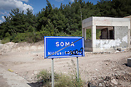 A sign at the beginning of Soma town in western Turkey. The population is written below, but as casualty figures are disputed graffiti and a black ribon of mourning have been placed over the sign.