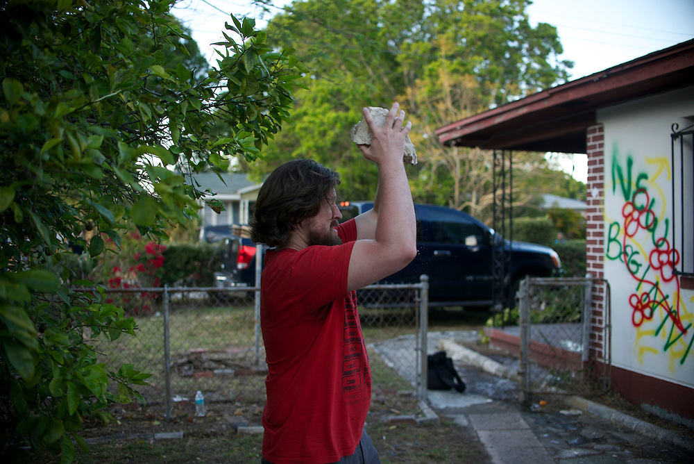 Photo by Matt Roth..Jonathan Tennis and his wife Angelina Tennis destroy the house he bought in2005 in Tampa, Florida on Saturday, March 30, 2013.