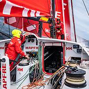 Leg 9, from Newport to Cardiff, day 04 on board MAPFRE, Antonio Cuervas-Mons at the mast, Tamara Echegoyen at the hatch. 23 May, 2018.