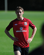 Joe Allen of Wales looks on. Wales football players training at the Vale, in Cardiff on Wed 5th Sept 2012, ahead of their forthcoming World cup qualifier against Belgium on Friday 8th Sept.  pic by  Andrew Orchard, Andrew Orchard sports photography,