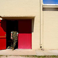 Instructor Emilio Barela returns to the gymnasium following  the Grants High School Marine Corps ROTC training at Grants High School Wednesday.