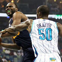April 11, 2011; New Orleans, LA, USA; Utah Jazz center Al Jefferson (25) is guarded by New Orleans Hornets center Emeka Okafor (50) during the first half at the New Orleans Arena.  Mandatory Credit: Derick E. Hingle