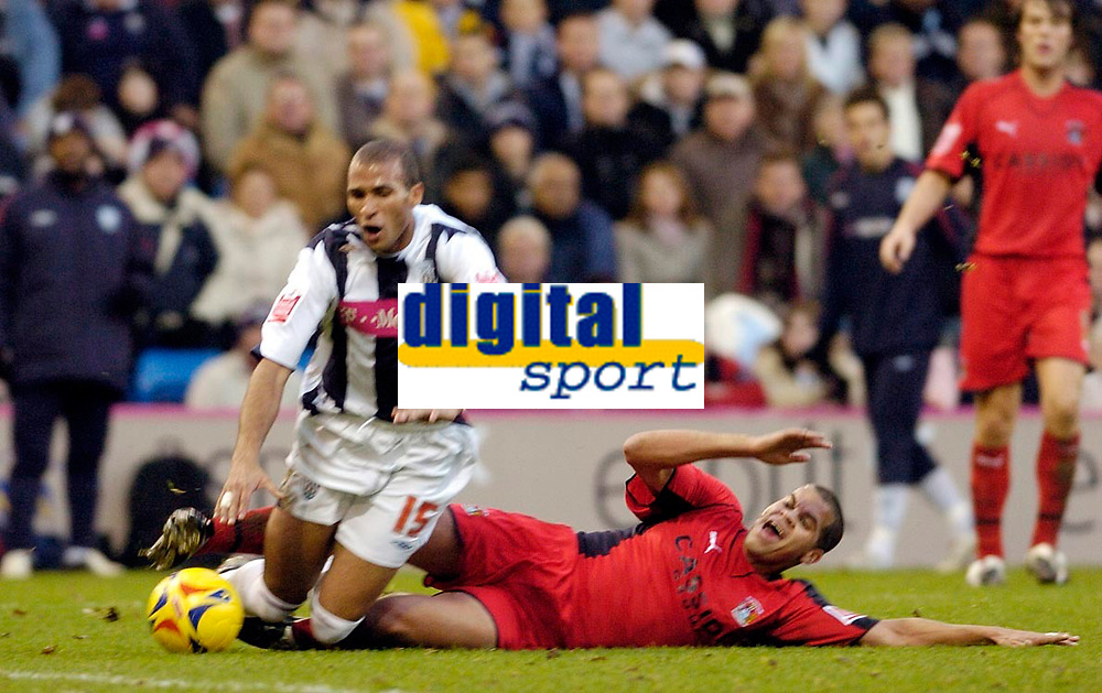 Photo: Leigh Quinnell.<br /> West Bromwich Albion v Coventry City. Coca Cola Championship. 16/12/2006. Coventrys Marcus Hall brings down West Broms Diomansy Kamara to give away a penalty.