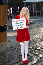 © Licensed to London News Pictures. 11/12/2013. London, UK. FHM magazine's Sexiest woman in the UK, Helen Flanagan. Helen today supported PETA in Covent Garden to encourage consumers to keep fur off their Christmas list this year. PETAs stance is that any fur product results in animal suffering. Photo credit : Simon Ford/LNP