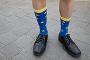 Anti Brexit protester wearing European Union flag socks in Westminster as inside Parliament the Tory leadership race continues on 1st July 2019 in London, England, United Kingdom.