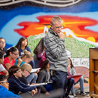 Bob Ippel, the new executive director of Rehoboth Christian School, prepares 7th-grade students for a Chattanooga Choo Choo rehearsal at the Mission House choir room in Rehoboth Wednesday.
