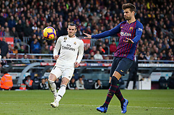 October 28, 2018 - Barcelona, Catalonia, Spain - Gerard Pique and Gareth Bale during the match between FC Barcelona and Real Madrid CF, corresponding to the week 10 of the Liga Santander, played at the Camp Nou, on 28th October 2018, in Barcelona, Spain. (Credit Image: © Joan Valls/NurPhoto via ZUMA Press)
