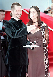 Gary Oldman and partner Donya Fiorentino arrive for the premiere of 'Nil by Mouth' in which he makes his directorial film debut at the Cannes  Film Festival.