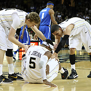 Central Florida guard Marcus Jordan (5) gets help from teammates Central Florida forward P.J. Gaynor (21) ande Central Florida guard Isaac Sosa (11) during a Conference USA NCAA basketball game between the Memphis Tigers and the Central Florida Knights at the UCF Arena on February 9, 2011 in Orlando, Florida. Memphis won the game 63-62. (AP Photo: Alex Menendez)