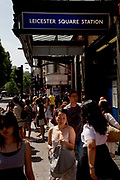 Leicester Square, a hugely popular area for tourism in the West End, London. Here the busy exit to the underground station.