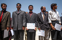 KABUL, AFGHANISTAN, AUGUST 4, 2002:   Afghans who were trained for the close protection team by Italian paratroopers working as part of the International Security and Assistance Force  in Afghanistan hold a ceremony marking their completion of the training August 4, 2002 in Kabul.(Photo  by Ami Vitale)