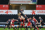 James King of the Ospreys © claims a line out ball.Guinness Pro12 rugby match, Ospreys v Scarlets at the Liberty Stadium in Swansea, South Wales on Saturday 26th March 2016.<br /> pic by  Andrew Orchard, Andrew Orchard sports photography.